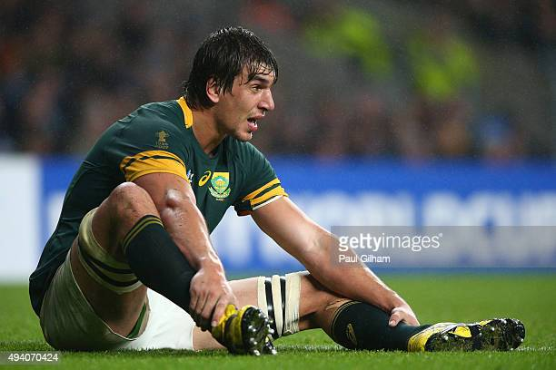 Eben Etzebeth of South Africa sits on the pitch holding his legs during the 2015 Rugby World Cup Semi Final match between South Africa and New...