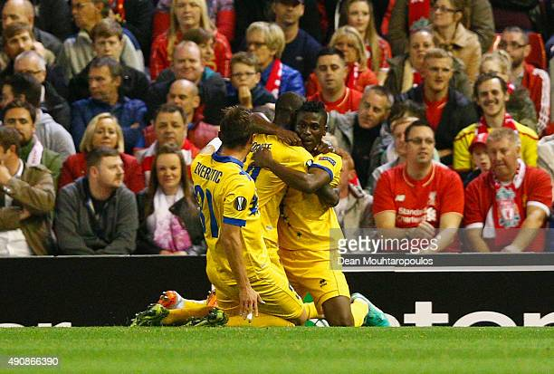 Ebenezer Assifuah of FC Sion celebrates scoring their first goal with team mates during the UEFA Europa League group B match between Liverpool FC and...