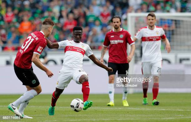 Ebenezer Ofori of VfB Stuttgart is challenged by Waldemar Anton of Hannover 96 during the Second Bundesliga match between Hannover 96 and VfB...