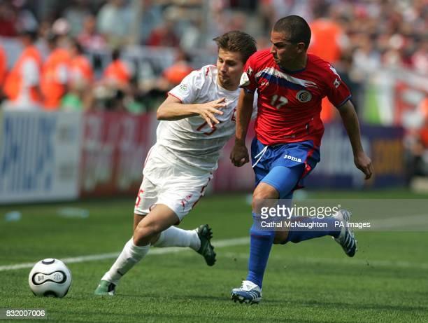 Ebi Smolarek Poland and Gabriel Badilla Costa Rica battle for the ball