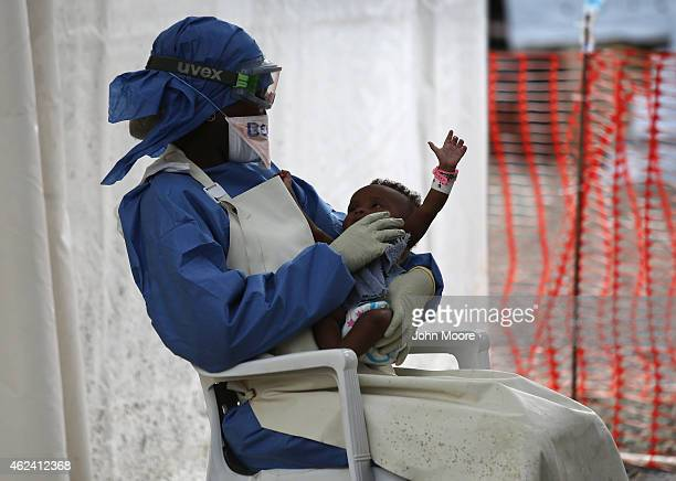 Ebola survivor and nurse's aid Benetha Coleman comforts an infant girl with Ebola symptoms in the highrisk area of the Doctors Without Borders Ebola...