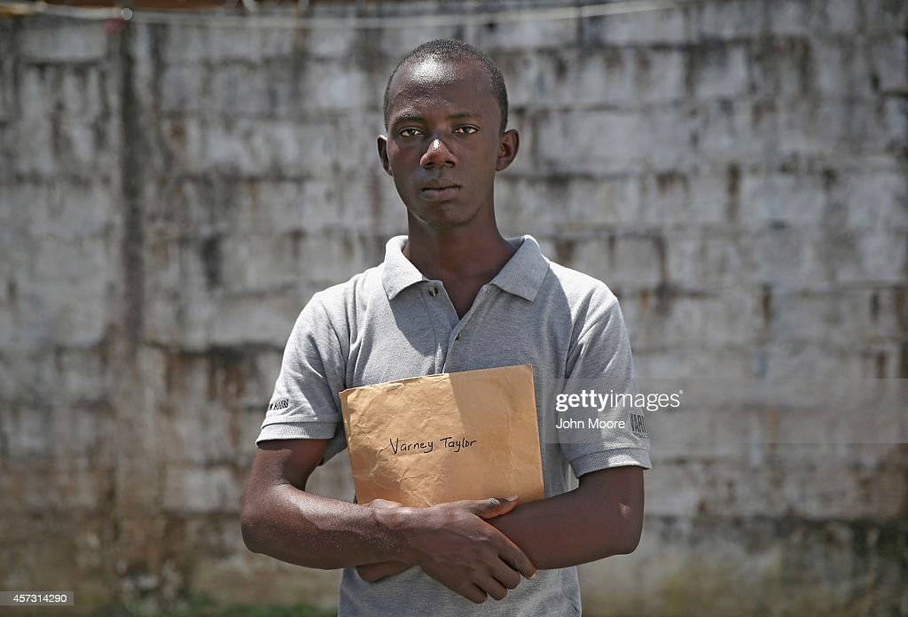 Ebola survivor Varney Taylor stands in the lowrisk section of the Doctors Without Borders Ebola treatment center after attending a survivors' meeting...