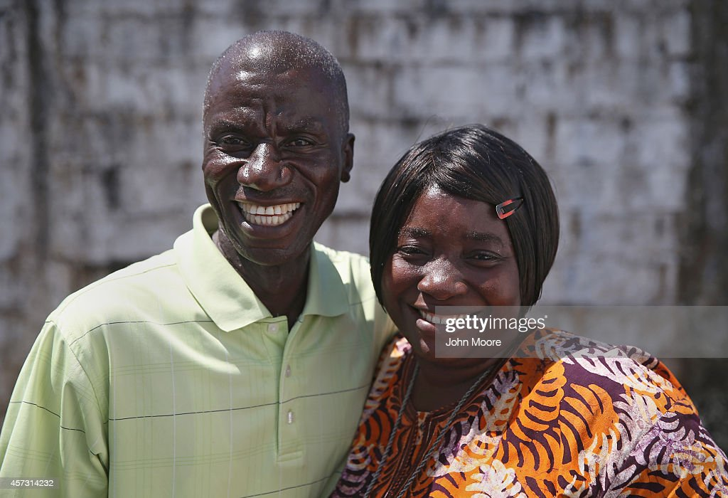 Ebola survivors Anthony Naileh and his wife Bendu Naileh stand at the Doctors Without Borders Ebola treatment center after meeting with fellow...