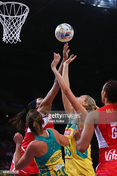 Eboni BeckfordChambers of England puts pressure on Caitlin Bassett Of Australia as she shoots during the 2015 Netball World Cup Qualification round...