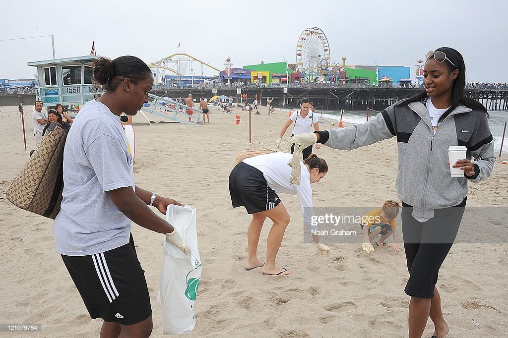 Ebony Hoffman, Jenna O'Hea and Latoya Pringle of the Los Angeles Sparks join forces with Waste Management and Heal the Bay to clean up Santa Monica beach as part of the WNBA's Go Green Week on August 13, 2011 in Los Angeles, California.
