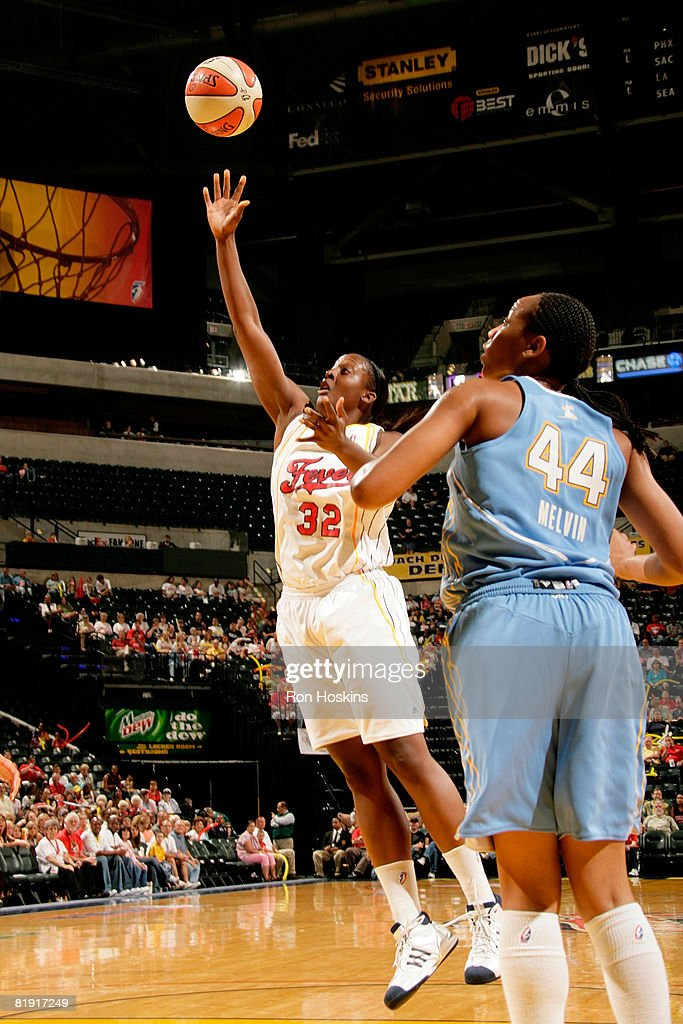 Ebony Hoffman of the Indiana Fever shoots over Chasity Melvin of the Chicago Sky at Conseco Fieldhouse on July 12 2008 in Indianapolis Indiana NOTE...