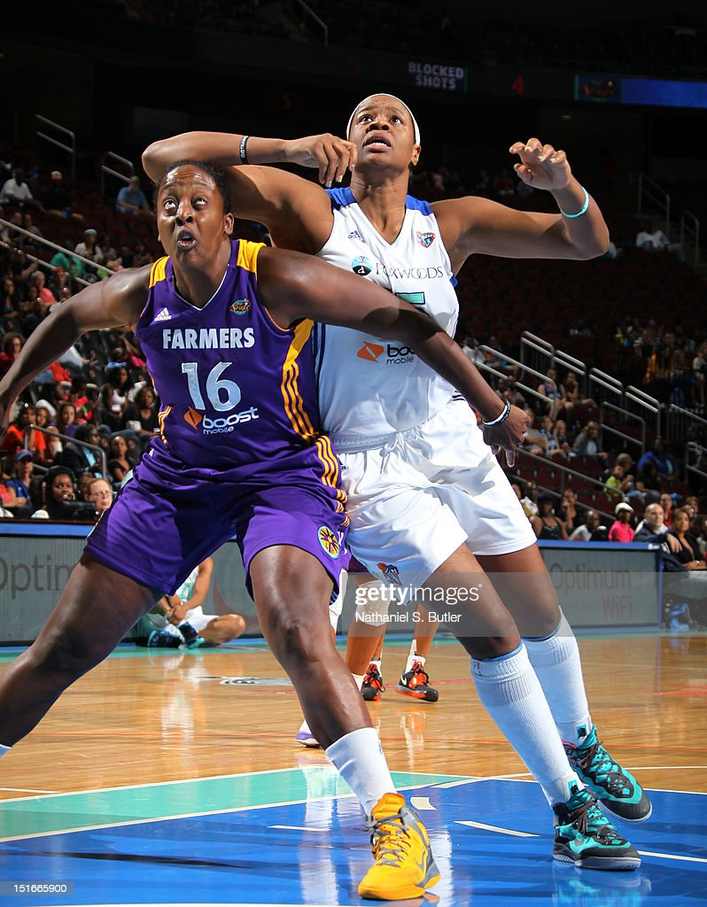 Ebony Hoffman of the Los Angeles Sparks postion for a rebound against Kia Vaughn of the New York Liberty during a game on September 9 2012 at the...