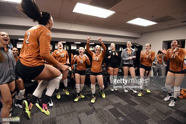 Ebony Nwanebu of the University of Texas celebrates with teammates after their win over Nebraska in the Division I Women's Volleyball Semifinals held...