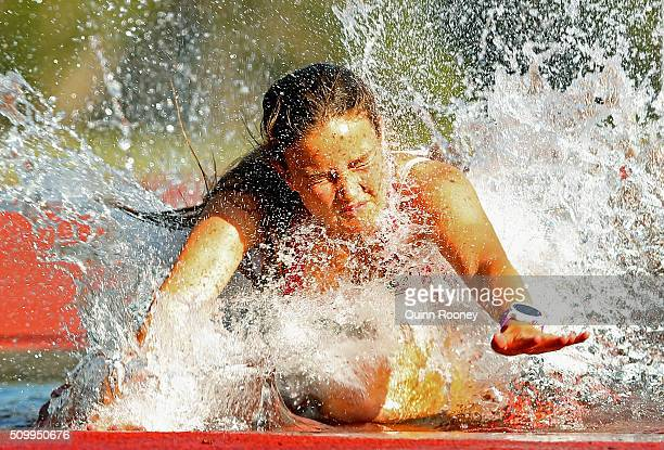Ebony Webb of Tasmania trips into the water in the Women's 2000 meter Steeplechase during the Briggs Athletics Classic on February 13 2016 in Hobart...