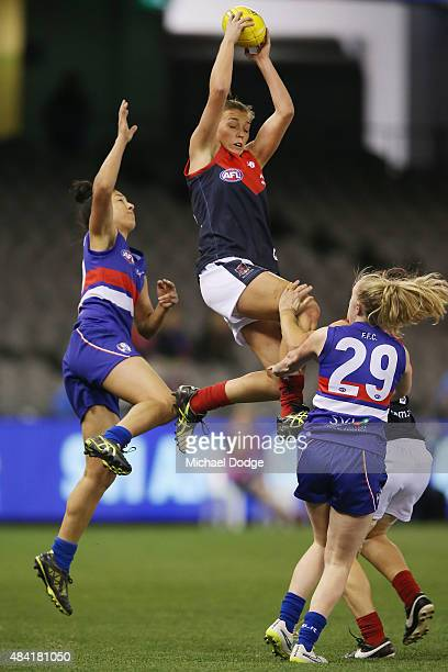 EbonyRose Antonio of the Demons takes a high mark over Emma Humphries of the Bulldogs during a Women's AFL exhibition match between Western Bulldogs...