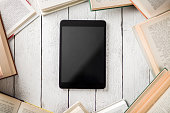 Black Ebook Reader with Many Paper Books