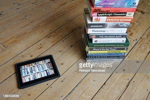 E-Books and paper books : Stock Photo