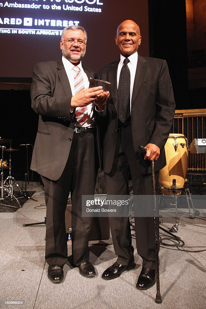 Ebrahim Rasool (L) and <a gi-track='captionPersonalityLinkClicked' href=/galleries/search?phrase=Harry+Belafonte&family=editorial&specificpeople=204214 ng-click='$event.stopPropagation()'>Harry Belafonte</a> pose onstage at the Shared Interest 19th Annual Awards Gala on March 18, 2013 in New York City.