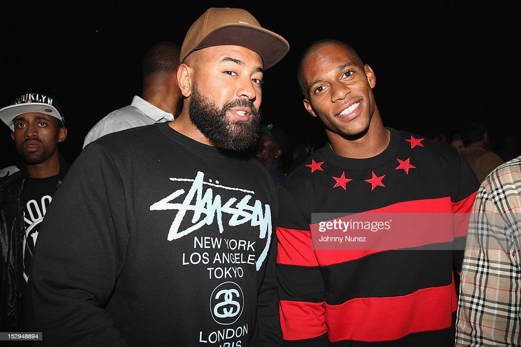 Ebro and Victor Cruz backstage at the exclusive D'USSE VIP Lounge at Barclays Center on September 28, 2012 in New York City.