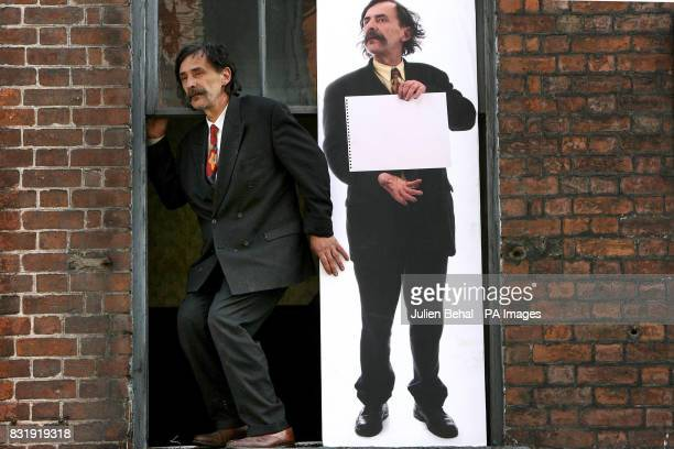 Eccentric artist Gerard Dowling performs a short sketch with a lifesize photograph of himself in the second floor window of his studio on Middle...