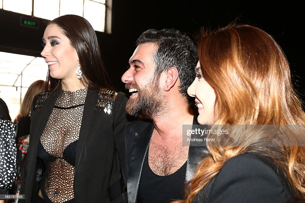 Ece Gursel and Hakan Akkaya attend the Mercedes Benz Fashion Week Istanbul Fall/Winter 2013/14 at Antrepo 3 on March 15, 2013 in Istanbul, Turkey.