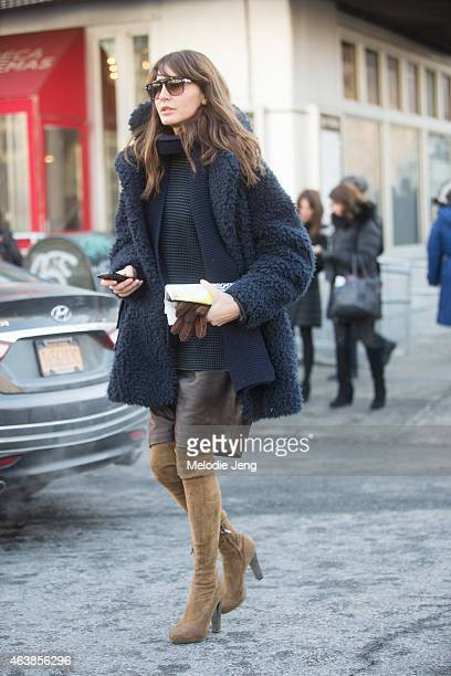 Ece Sukan exits the Michael Kors show on the streets of Manhattan on February 18 2015 in New York City
