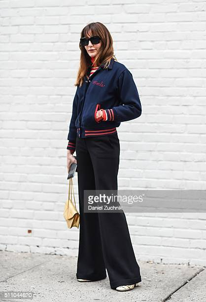 Ece Sukan is seen outside the DKNY show wearing a varsity jacket during New York Fashion Week Women's Fall/Winter 2016 on February 17 2016 in New...