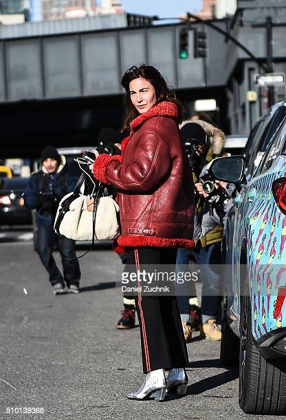 Ece Sukan is seen outside the Tibi show wearing a red leather and fur trim coat during New York Fashion Week Women's Fall/Winter 2016 on February 13...