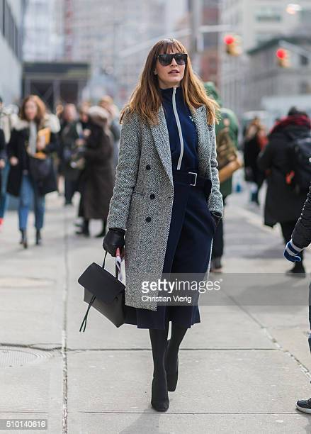 Ece Sukan is wearing a grey coat a blue seen outside Jason Wu during sportswear jacket and a blue skirt New York Fashion Week Women's Fall/Winter...