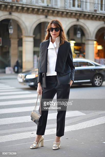 Ece Sukan poses wearing Dice Kayek before the Dice Kayek show at the Musee des Arts Decoratifs during Haute Couture on January 25 2016 in Paris France