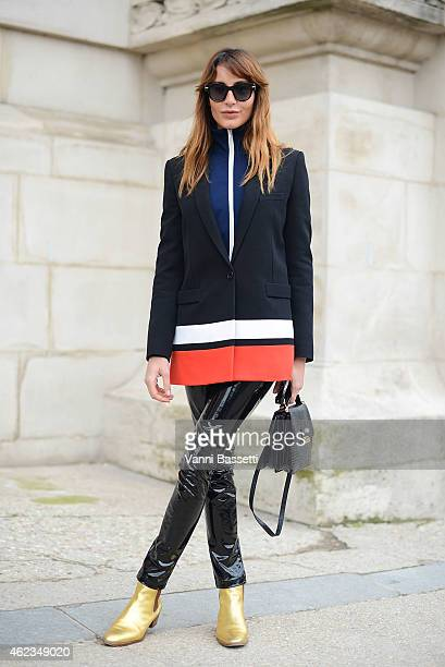 Ece Sukan poses wearing Givenchy jacket and St Laurent shoes during day 3 of Paris Haute Couture Spring Summer 2015 on January 27 2015 in Paris France