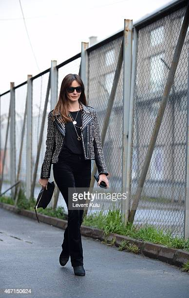 Ece Sukan poses wearing jacket by Barbara Bui pants by J Brand tshirt by Marni boot by Chanel sunglasses by Saint Laurent hand bag and charm by...