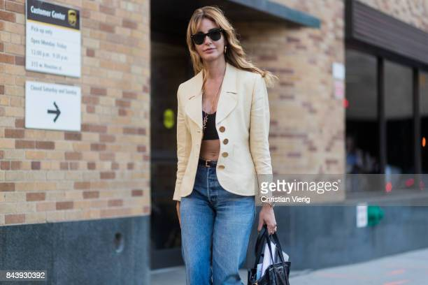 Ece Sukan seen wearing a cropped top blazer denim jeans in the streets of Manhattan outside Adam Selman during New York Fashion Week on September 7...