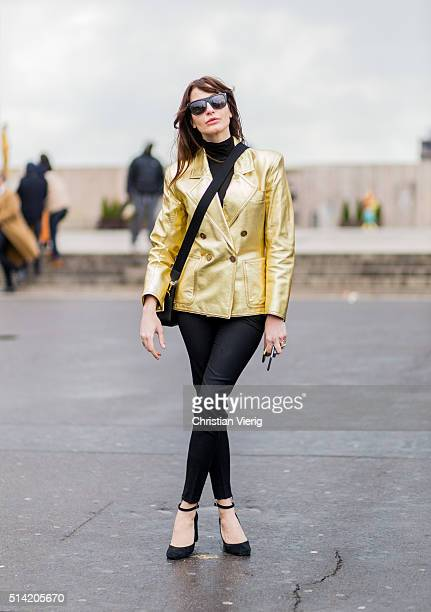 Ece Sukan wearing a golden jacket outside Sacai during the Paris Fashion Week Womenswear Fall/Winter 2016/2017 on March 7 2016 in Paris France