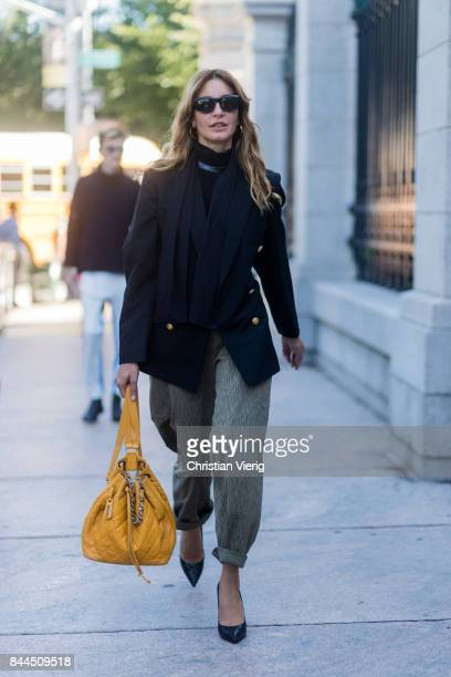 Ece Sukan wearing a mustard Chanel backpack khaki pants seen in the streets of Manhattan outside Tory Burch during New York Fashion Week on September...