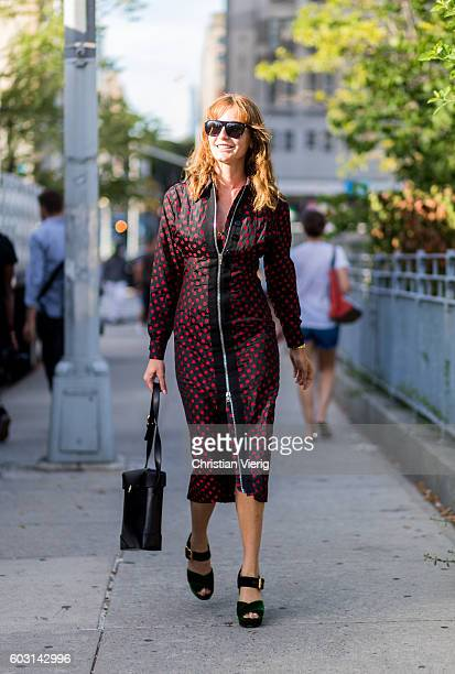 Ece Sukan wearing a red dress outside Altuzarra on September 11 2016 in New York City