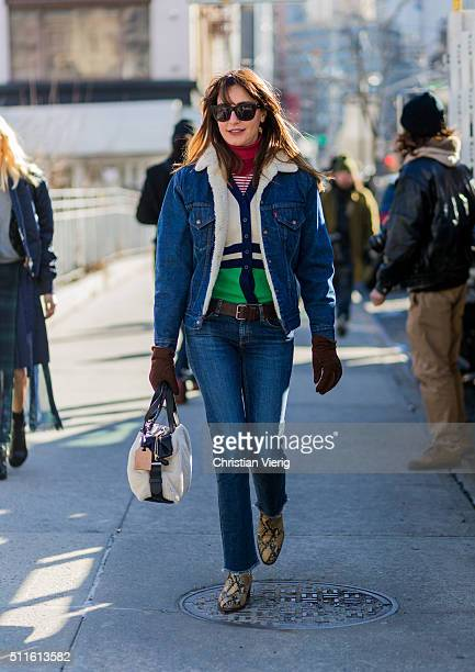 Ece Sukan wearing a shearling denim jacket and denim jeans and brown gloves seen outside Calvin Klein during New York Fashion Week Women's...