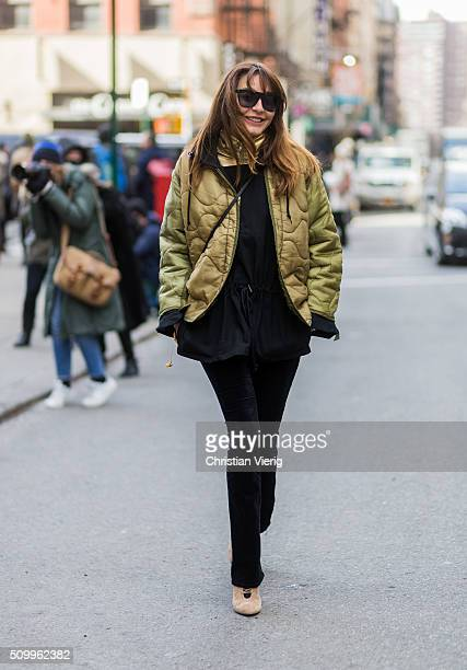 Ece Sukan wearing an olivegreen bomber jacket and a leopard patterned bomber jacket seen outside Creatures of the Wind during New York Fashion Week...