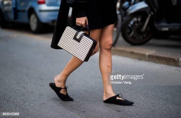 Ece Sukan wearing black dress white bag is seen outside Dolce Gabbana during Milan Fashion Week Spring/Summer 2018 on September 24 2017 in Milan Italy