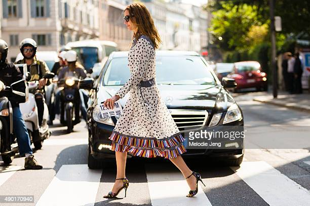Ece Sukan wears a white patterend dress with a colorful fringe during the Milan Fashion Week Spring/Summer 16 on September 26 2015 in Milan Italy