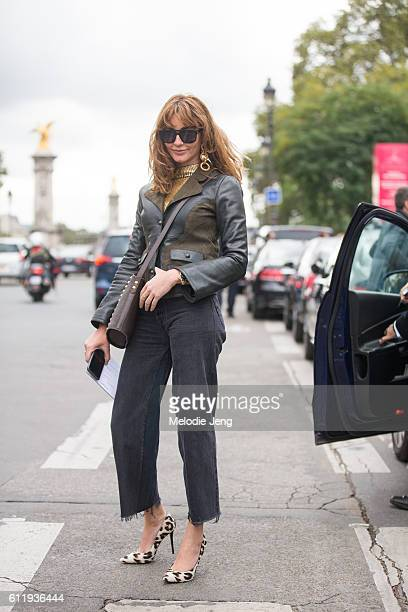Ece Sukan wears oversized earrings outside the Mugler show at Grand Palais on October 1 2016 in Paris France