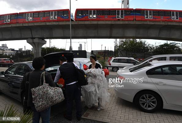 Echo Li and her fiance Charles Qian prepare to drive to St Paul's Cathedral to start their prewedding photography shoot on October 11 2016 in London...