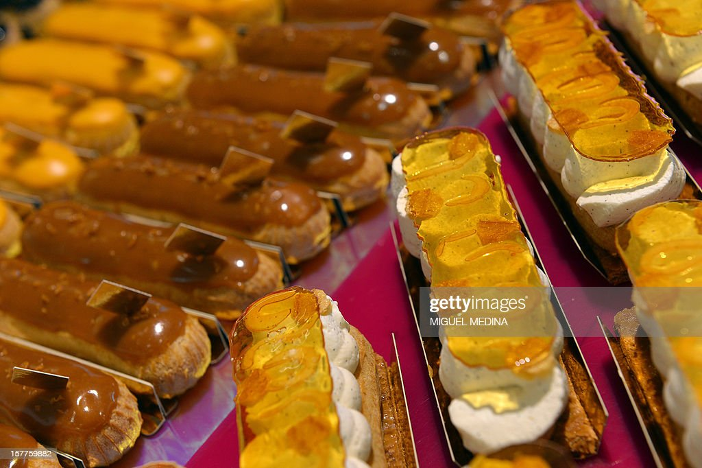 Eclairs pastries are displayed at a shop of French gourmet food company Fauchon, on December 6, 2012 in Paris. AFP PHOTO MIGUEL MEDINA