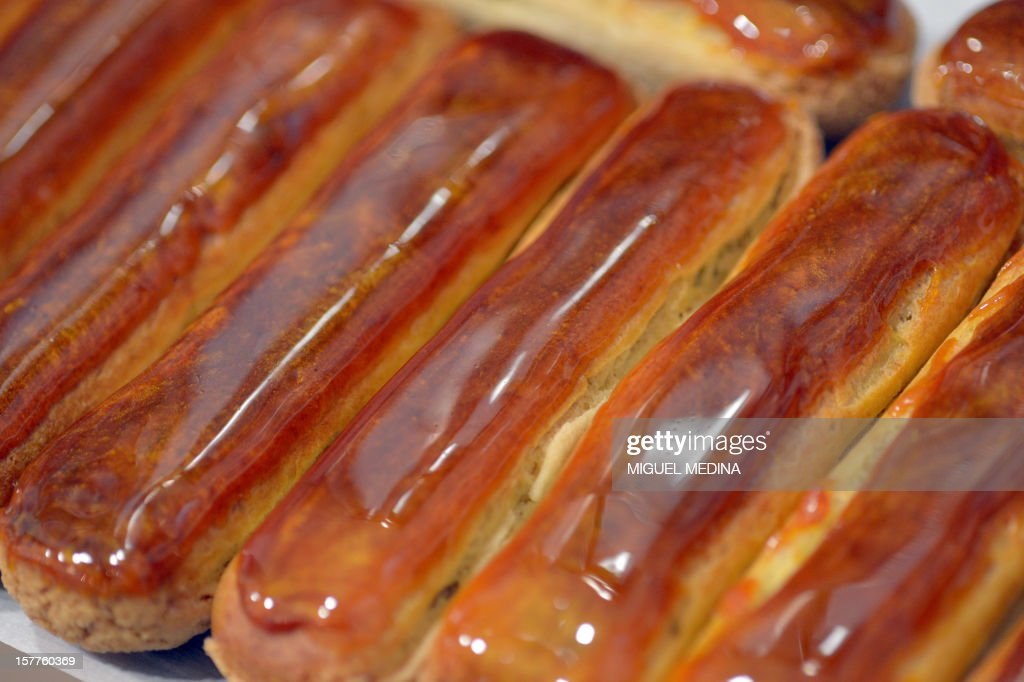 Eclairs pastries are displayed at the 'Atelier de l'eclair' (Eclair's workshop) in Paris, on December 6, 2012. AFP PHOTO MIGUEL MEDINA