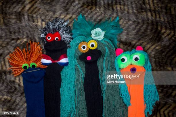 Eclectic Group of Sock Puppets Looking at Camera
