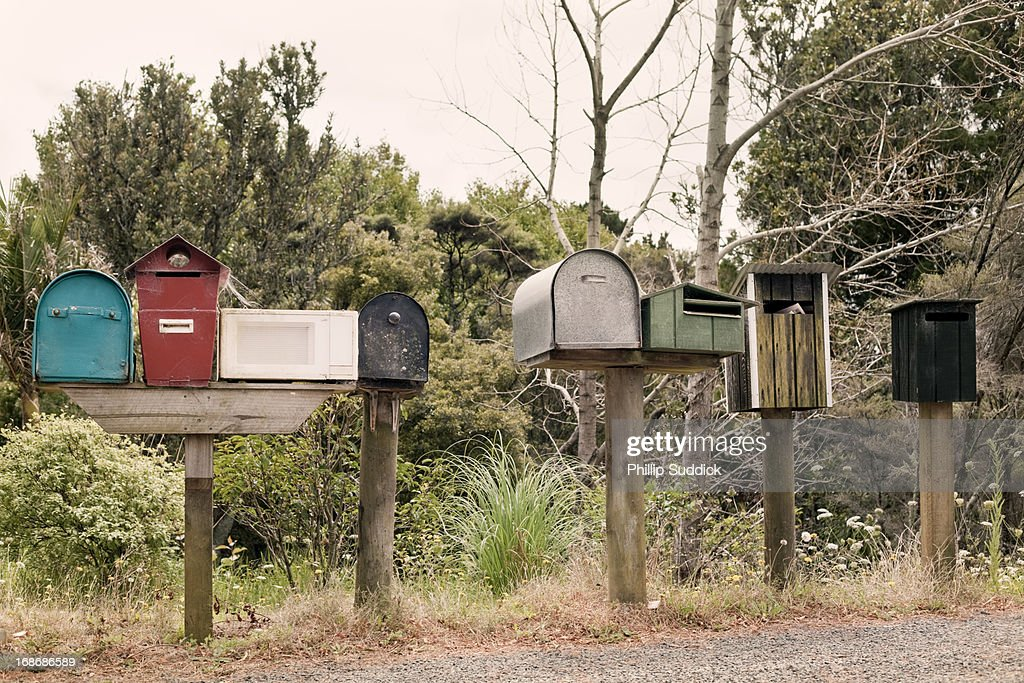 Eclectic mix letter boxes : Stock Photo