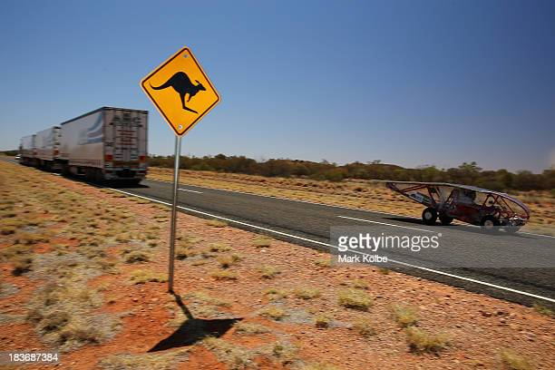 Eclipse 8 from the Ecole de technologie superieure team Canada races past a road train in the Clipsal and Schneider Electric Challenger Class on Day...