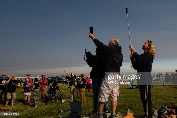 Eclipse enthusiasts observe the total solar eclipse moments before totality Monday August 21 2017 in Madras Oregon / AFP PHOTO / ROB KERR Emotional...