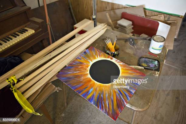 Eclipse themed artwork lays on a table in an artists studio ahead of a total solar eclipse in Makanda Illinois US on Saturday Aug 19 2017 Millions of...