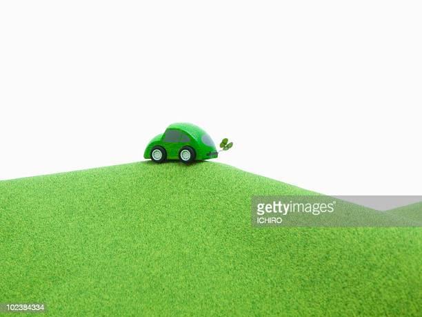 Eco car and a four-leaf clover.
