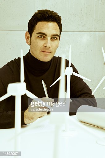 Eco engineer with wind turbines : Stock Photo