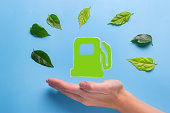 eco gasoline concept. green petrol station on blue background