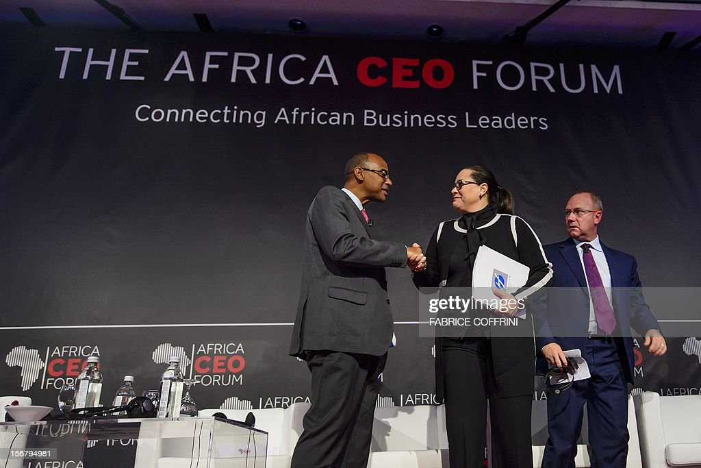 Ecobank Group chief executive officer Thierry Tanoh of Ivory Coast (L) shakes hands with Moroccan General Confederation of Enterprises (CGEM) president Meriem Bensalah (C) before Anglogold Ashanti chief executive officer Mark Cutifani of Australia on November 21, 2012 at the end of the 'What development strategies should African companies employ?' plenary session at the first Africa CEO Forum in Geneva.