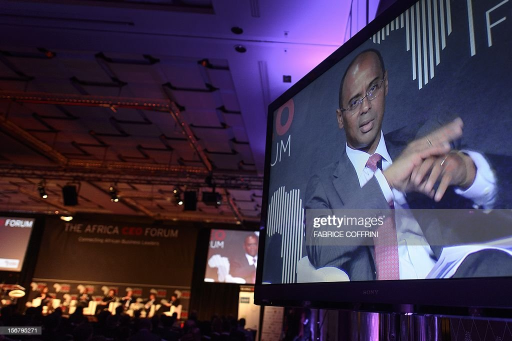 Ecobank Group chief executive officer Thierry Tanoh of Ivory Coast appears on a TV screen on November 21, 2012 during the 'What development strategies should African companies employ?' plenary session at the first Africa CEO Forum in Geneva.
