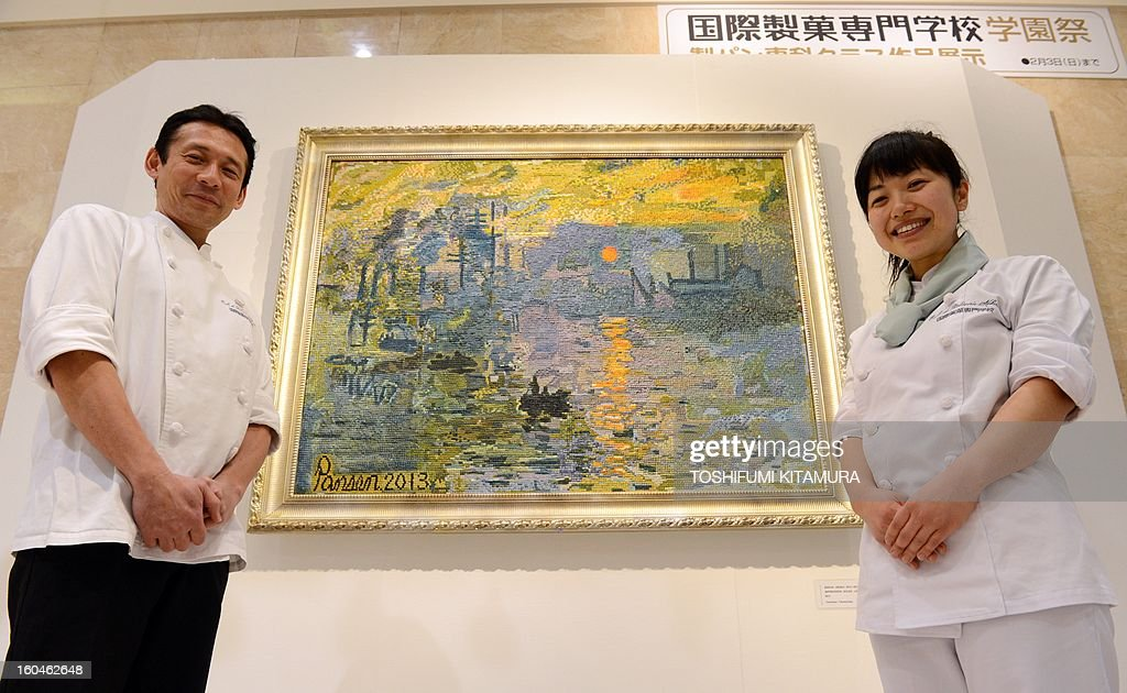 Ecole de Patisserie Kokusai, or International Confectionery Collage teacher Kazufumi Kawasaki (L) and student Rie Nakamura (R) pose next to their production of French painter Claude Monet's 'Impression, Sunrise,' made of 5mm-square bread pieces during an exhibition at a Tokyo department store on February 1, 2013. The college's 12 students spent one month to create the 105-centimetre-wide and 140-centimetre-high piece. AFP PHOTO / TOSHIFUMI KITAMURA